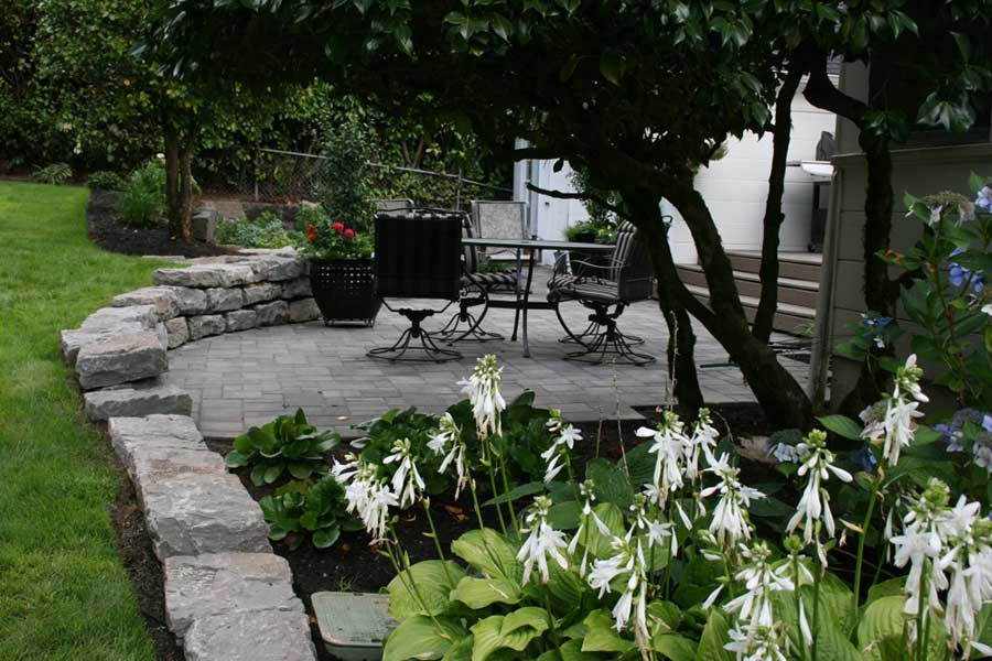 gray stone patio with patio furniture 3