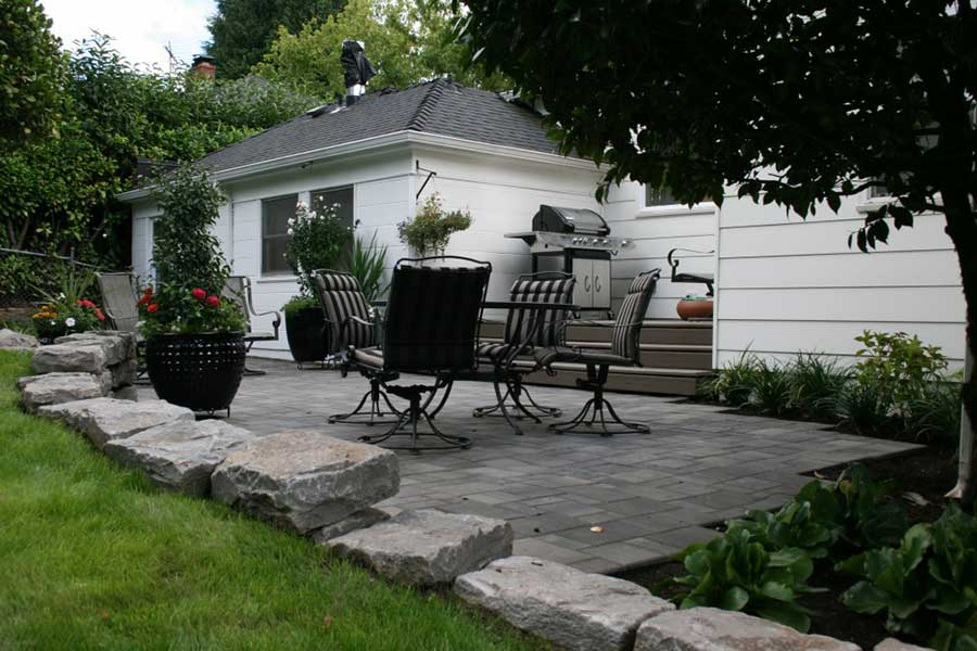 gray stone patio with patio furniture