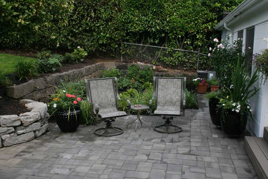 patio chairs and small table on stone patio