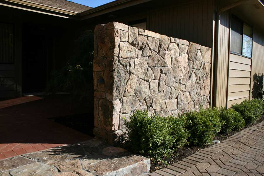 large natural stone wall on main home entryway