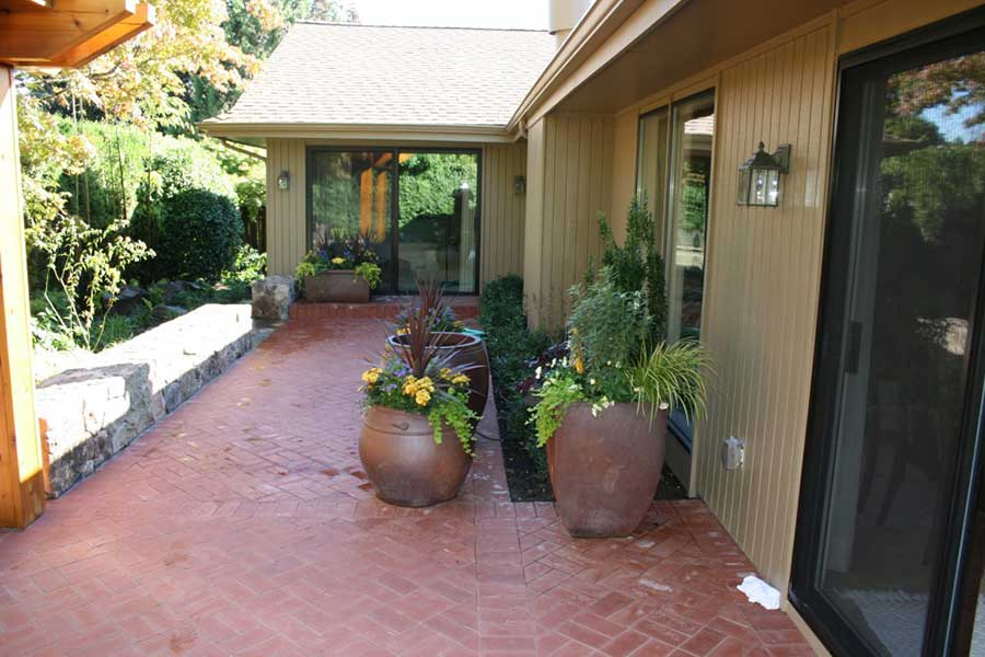 large outdoor vases on red brick patio