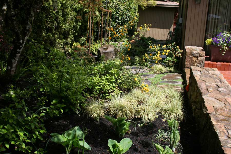 shaded garden and natural stone wall