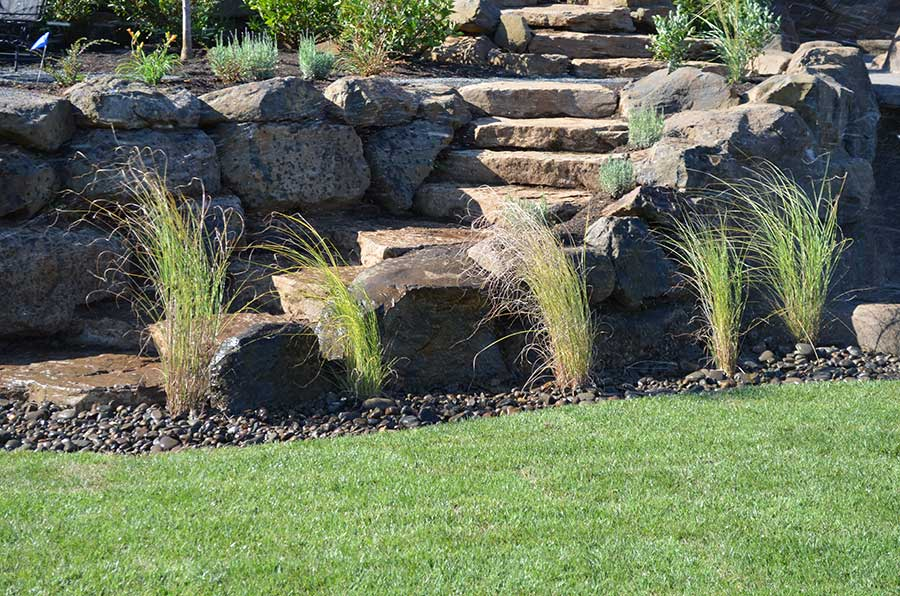 pebble bed with native grasses line semicircular stone steps