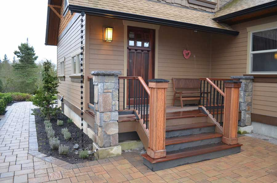house entry with small porch with steps and railing