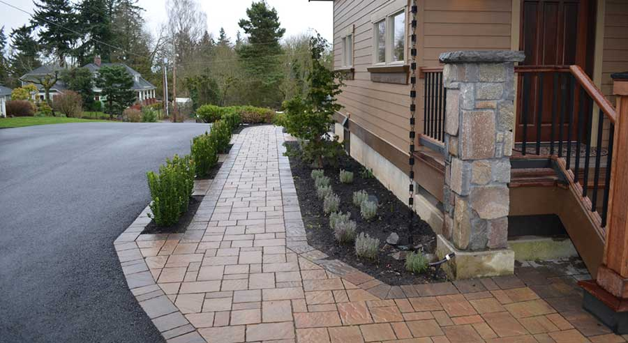 intricate brick pathway with embedded planters along side of house 3