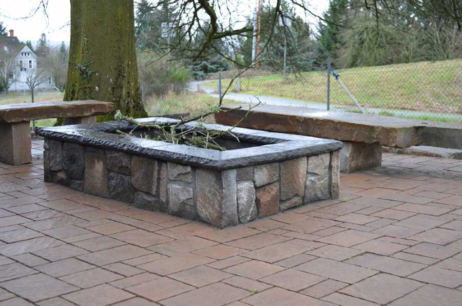 stone benches and square stone planter with branches