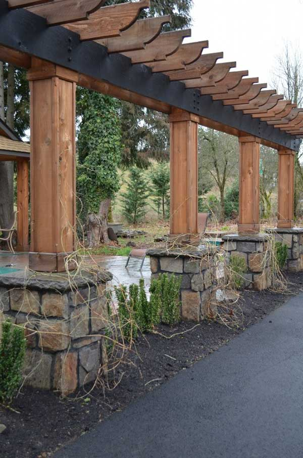 wood pergola planter and fence with flagstone supports
